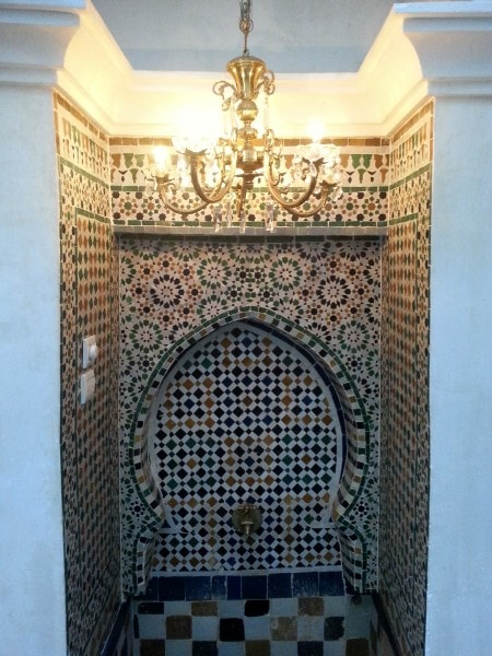 A stunning and traditional Moroccan fountain within the Guest House in Fez.